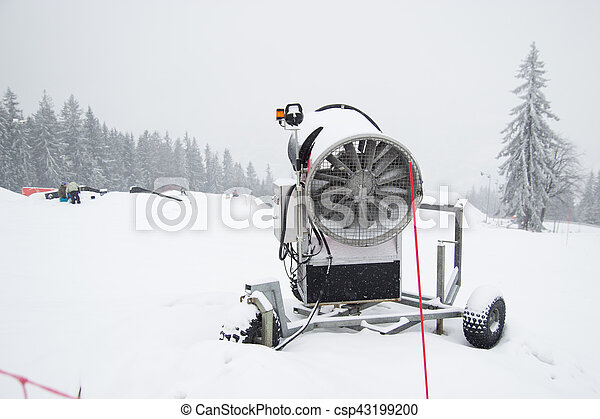 A snow cannon being used to cover a mountain - Snowmaking - csp43199200