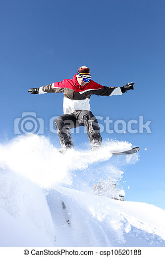 A snowboarder gliding through the air - csp10520188