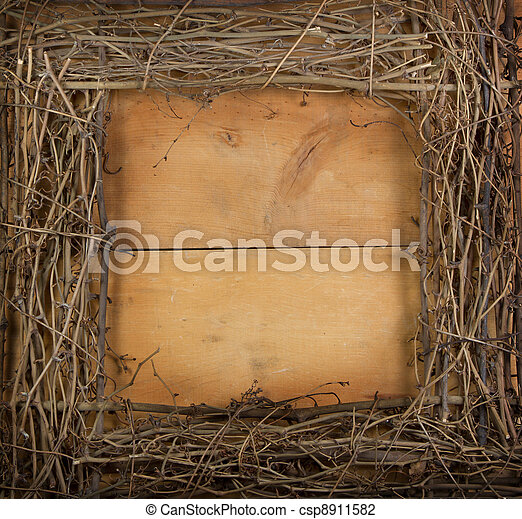 A square grapevine wreath on a wooden background - csp8911582