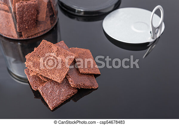 A stack of chocolate cookies - csp54678483