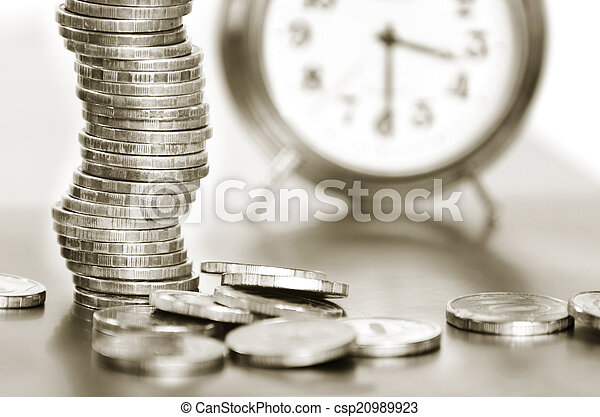 A stack of coins and alarm clock - csp20989923