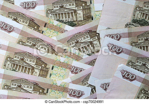 A stack of Russian banknotes of a hundred rubles close up. Money background - csp70024991