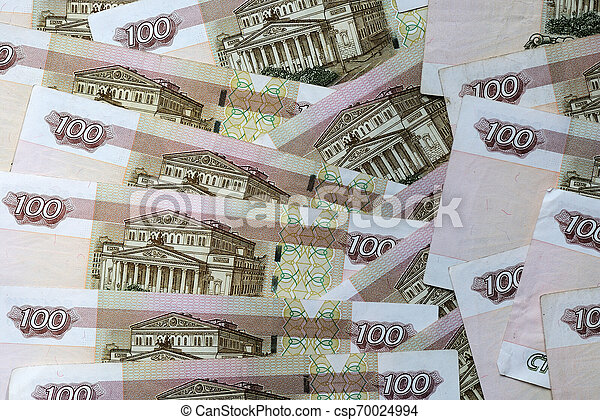 A stack of Russian banknotes of a hundred rubles close up. Money background - csp70024994