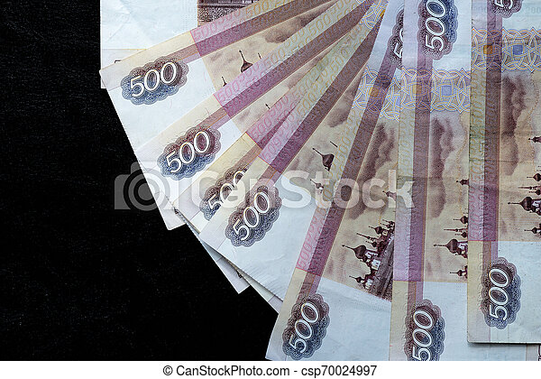 A stack of Russian banknotes of five hundred rubles on a dark background close up - csp70024997