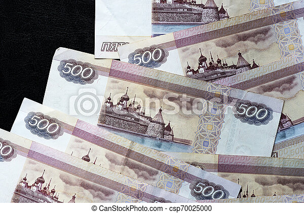 A stack of Russian banknotes of five hundred rubles on a dark background close up - csp70025000