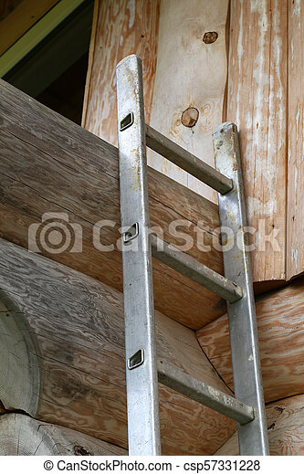 A staircase attached to a wooden wall - csp57331228