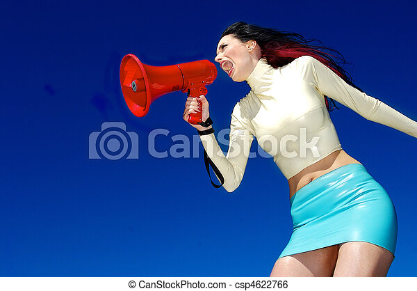 A stock photograph of a beautiful woman yelling into a mega phone. - csp4622766
