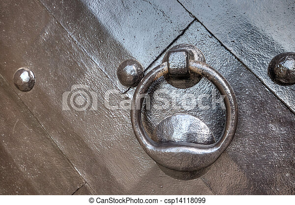 A strong wooden door with heavy rivets - csp14118099