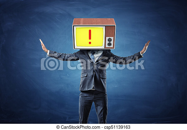 A successful businessman raises his hands to his head replaced with an old TV showing a red exclamation point. - csp51139163