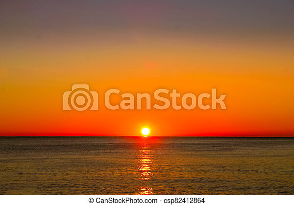 A sunset over the ocean - csp82412864