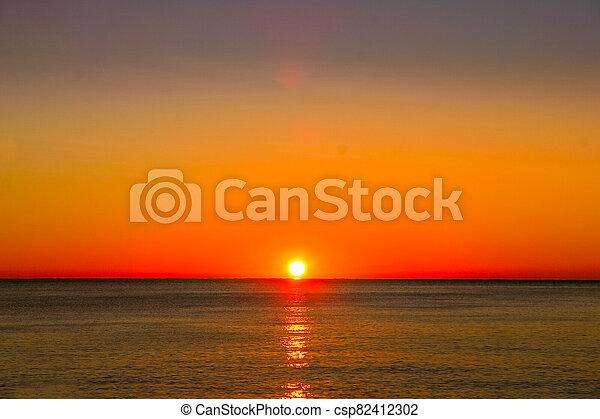 A sunset over the ocean - csp82412302