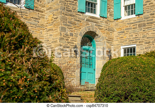 A Teal Front Door on a Suburban Home - csp84707310