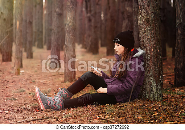 a teenager with a mobile phone - csp37272692