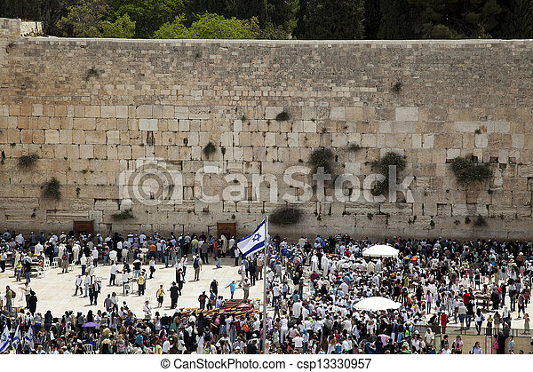 A Thursday morning at the Western Wall, one of the most sacred places to the Jewish religion. The  place is filled with Bar-Mitzvah boys and their families, practicing the ceremony of putting on phyla - csp13330957