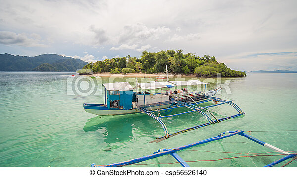 A Tourist Boat On The Background Of The Island Cyc Beach Coron Palawan Philippines