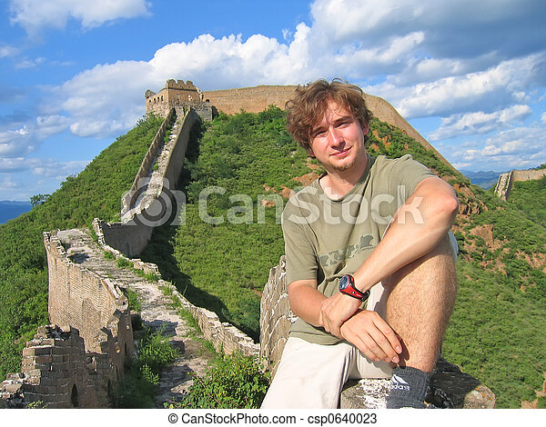 A trekker man having some rest on the Great Wall of China - China. - csp0640023