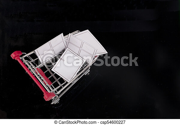 A trolley on black background. Shopping concept. - csp54600227