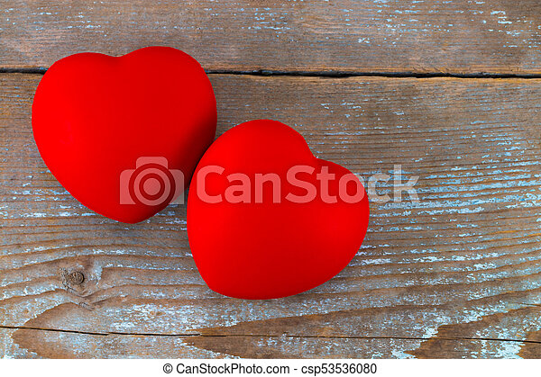 A two red heart on the wooden background - csp53536080