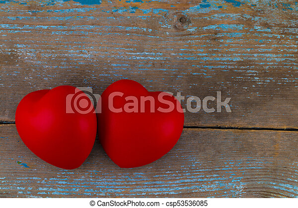 A two red heart on the wooden background - csp53536085