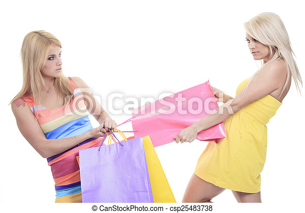 A ungry female shoppers smiling - isolated over a white backgrou - csp25483738