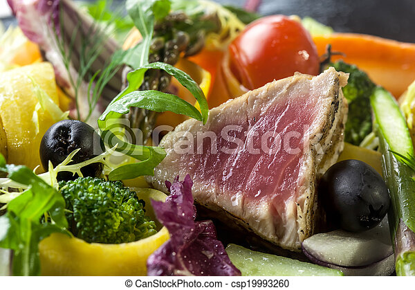 Avariety of fresh and blanched seasonal vegetables with grilled tuna,quaill egg, - csp19993260