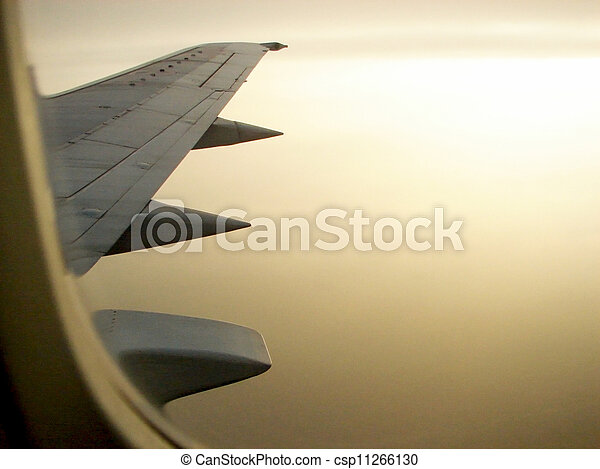 A view through the window of an airplane wing - csp11266130