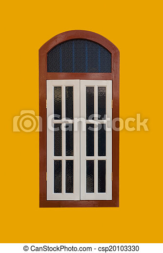 A vintage window on yellow wall - csp20103330