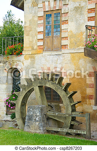 A water wheel at the Queen's Hamlet, Marie Antoinette's village at Versailles, France - csp8267203