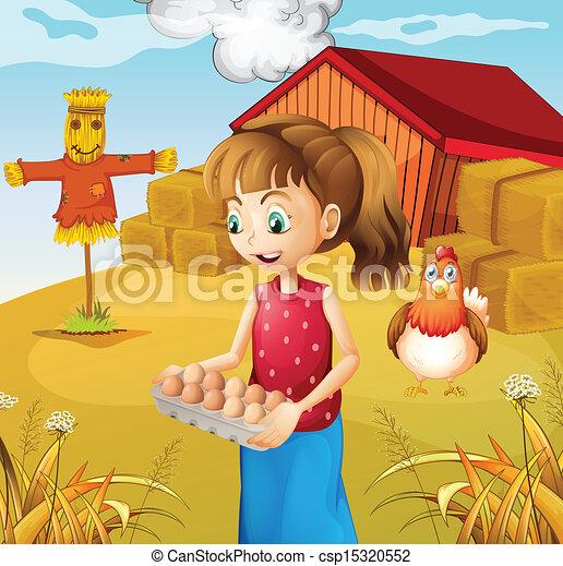 A woman harvesting eggs - csp15320552