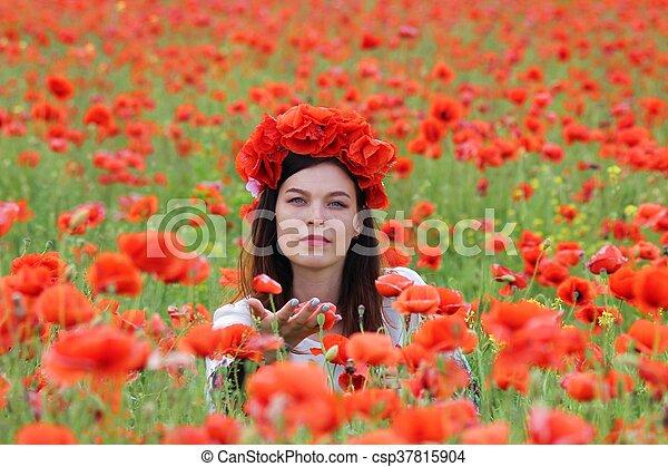 A woman in poppy field - csp37815904