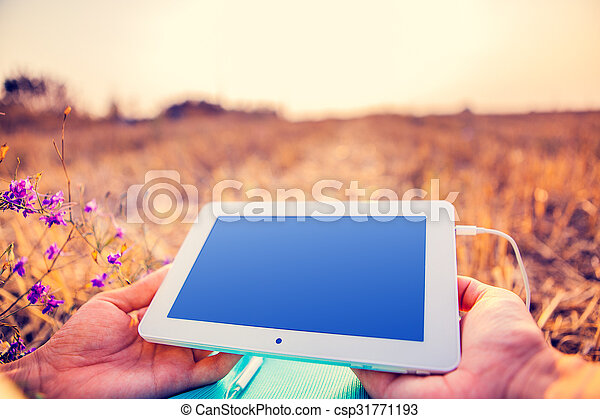 a woman in the field sits on earth with a plane-table in hands - csp31771193