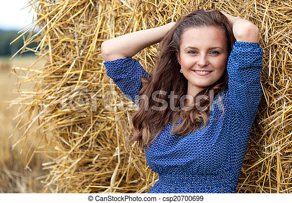 A woman in the field - csp20700699