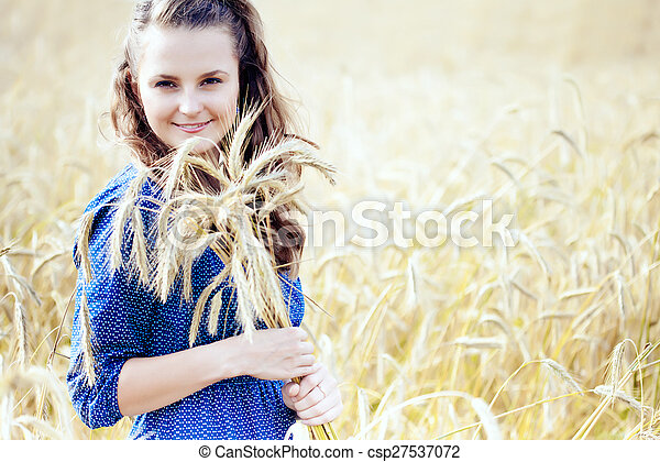 A woman in the meadow - csp27537072