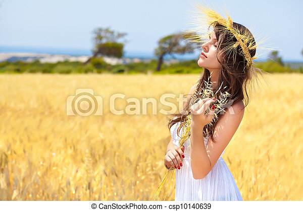 A woman is in the field with a wreath - csp10140639