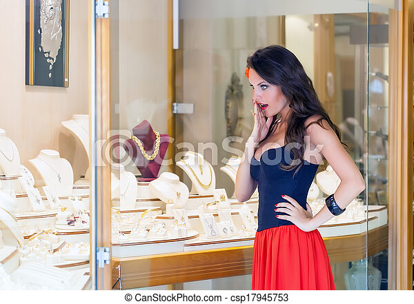 A woman is in the jewelry store - csp17945753