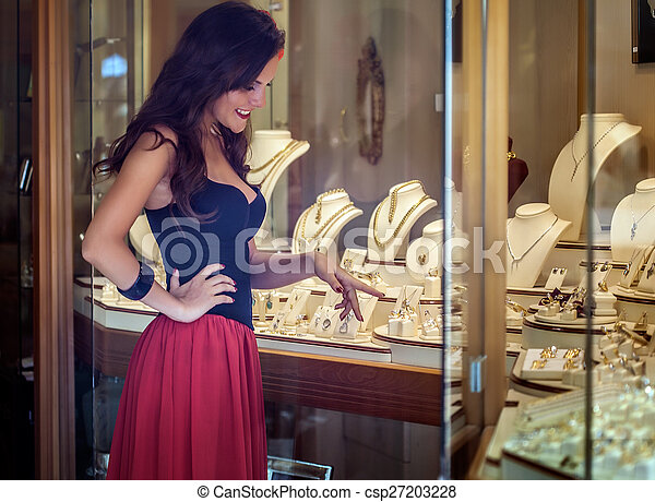 A woman is in the jewelry store - csp27203228