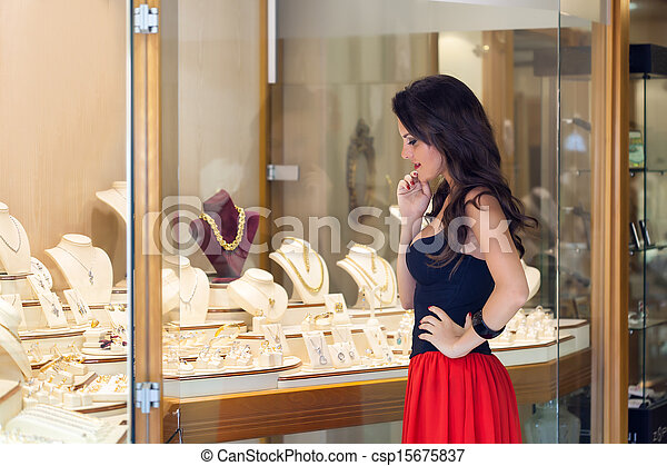 A woman is in the jewelry store - csp15675837