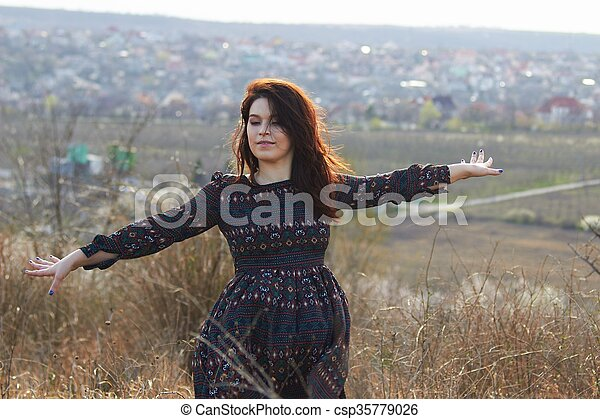 A woman pretending to fly - csp35779026