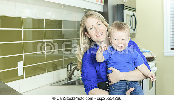 A Woman with Boy on the kitchen - csp25554266