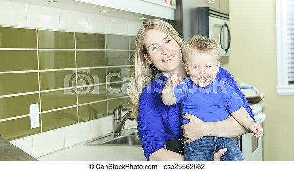 A Woman with Boy on the kitchen - csp25562662