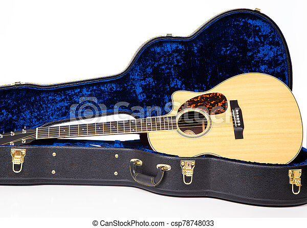 A wooden acoustic guitar in case on white background - csp78748033