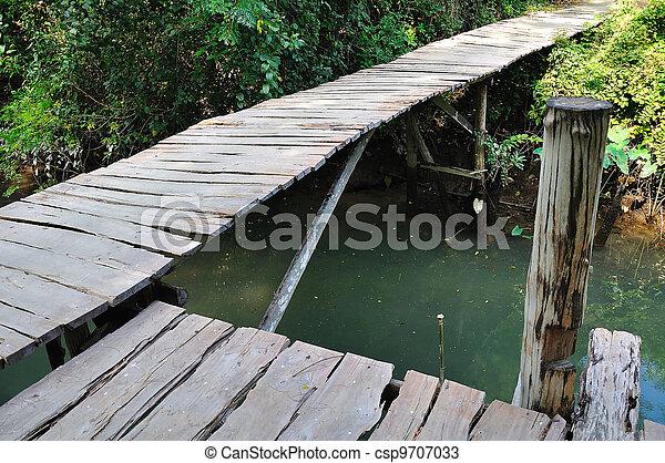 A wooden bridge on river - csp9707033