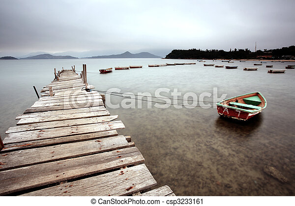 a wooden pier and boats - csp3233161