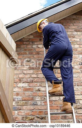 A workman up a ladder - csp10189446