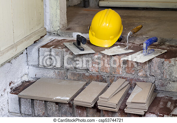 A workplace for a master from laying tiles. Tools and accessories as well as tiles when laying. - csp53744721