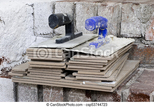A workplace for a master from laying tiles. Tools and accessories as well as tiles when laying. - csp53744723