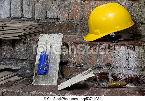 A workplace for a master from laying tiles. Tools and accessories as well as tiles when laying. - csp53744931