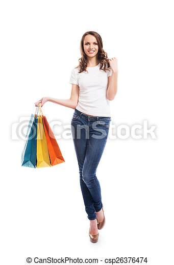 A young, attractive and happy shopping girl with bright shopping - csp26376474