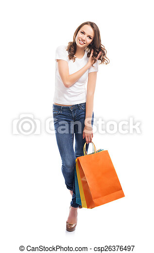 A young, attractive and happy shopping girl with bright shopping - csp26376497