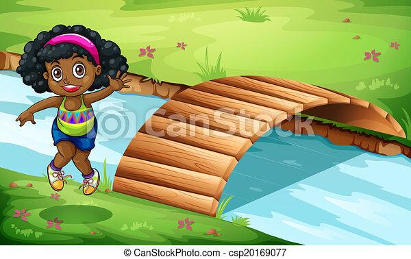 A young Black girl near the wooden bridge - csp20169077